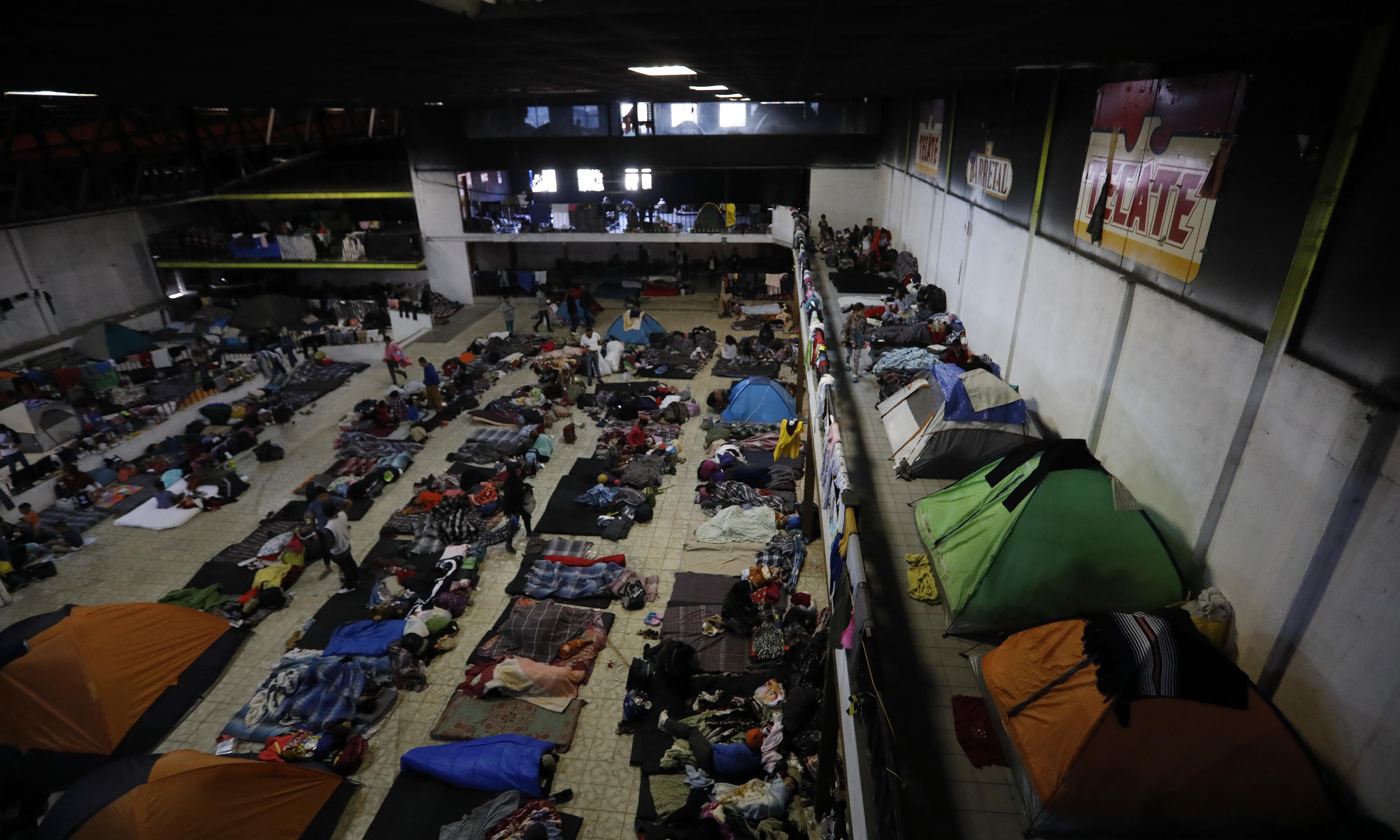What is forcing thousands of migrants to flee their home countries?