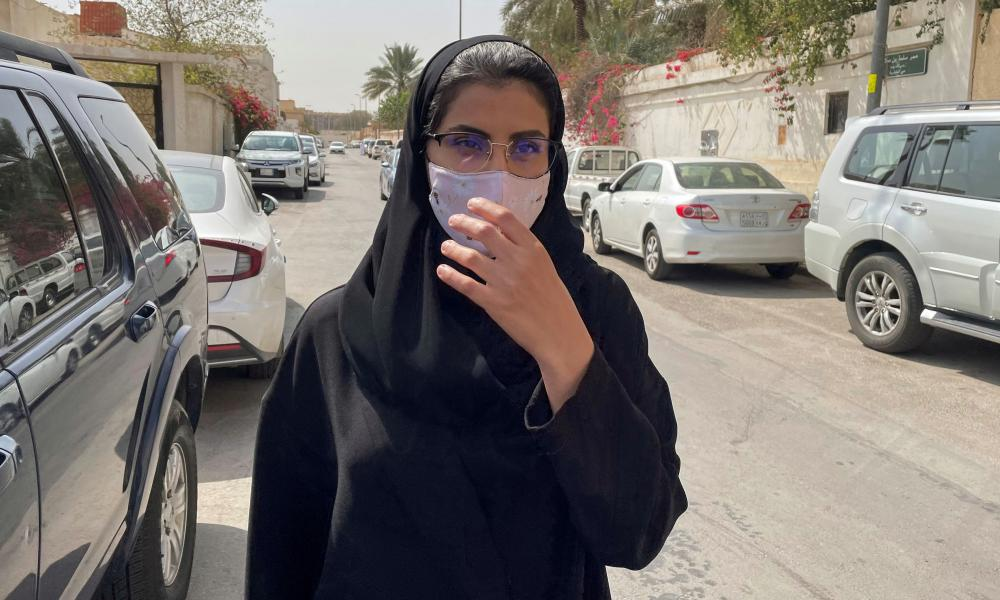 Saudi activist Loujain al-Hathloul makes her way to appear at a special criminal court for an appeals hearing, in Riyadh, March, 2021.