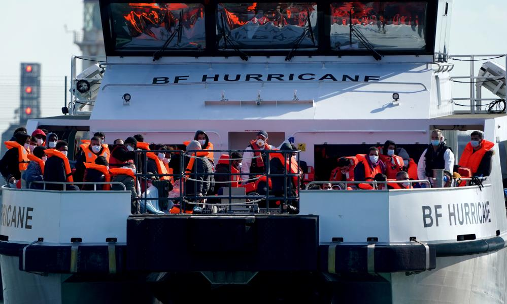 A group of people thought to be migrants are brought in to Dover, Kent, on board a Border Force vessel on Friday.