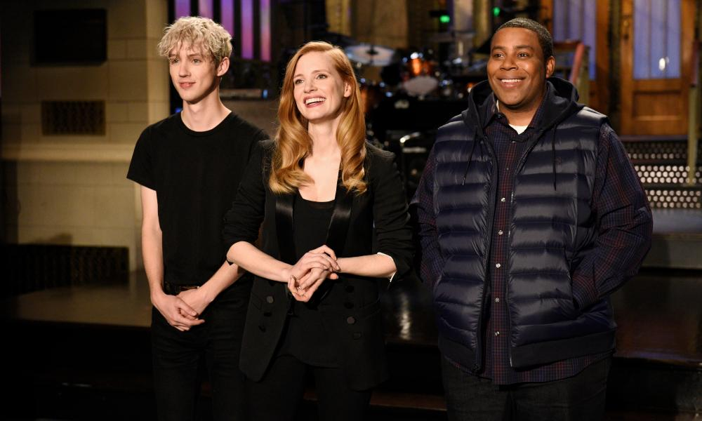 Saturday Night Live host Jessica Chastain, with musical guest Troye Sivan, left, and Kenan Thompson.