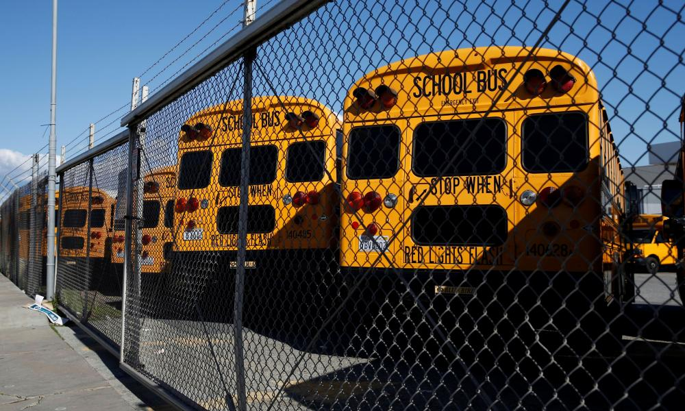 School buses are seen parked at First Student Charter Bus Rental in San Francisco, California, US 7 April, 2020.