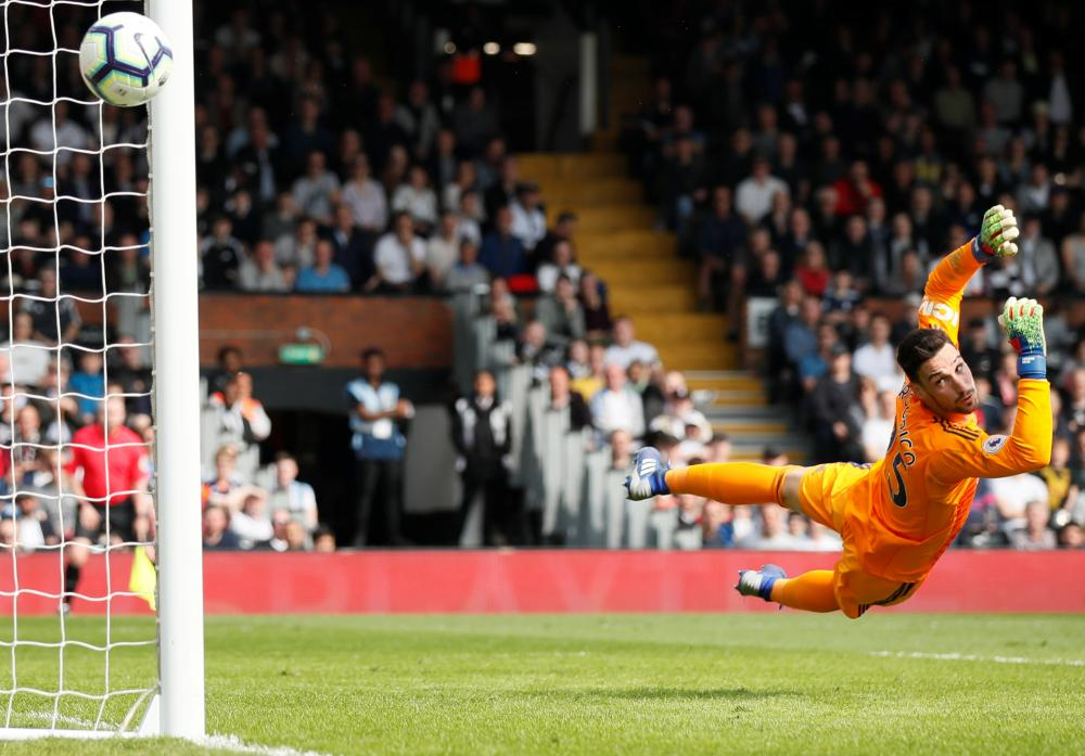 A relieved Sergio Rico watches the ball sail past the upright.