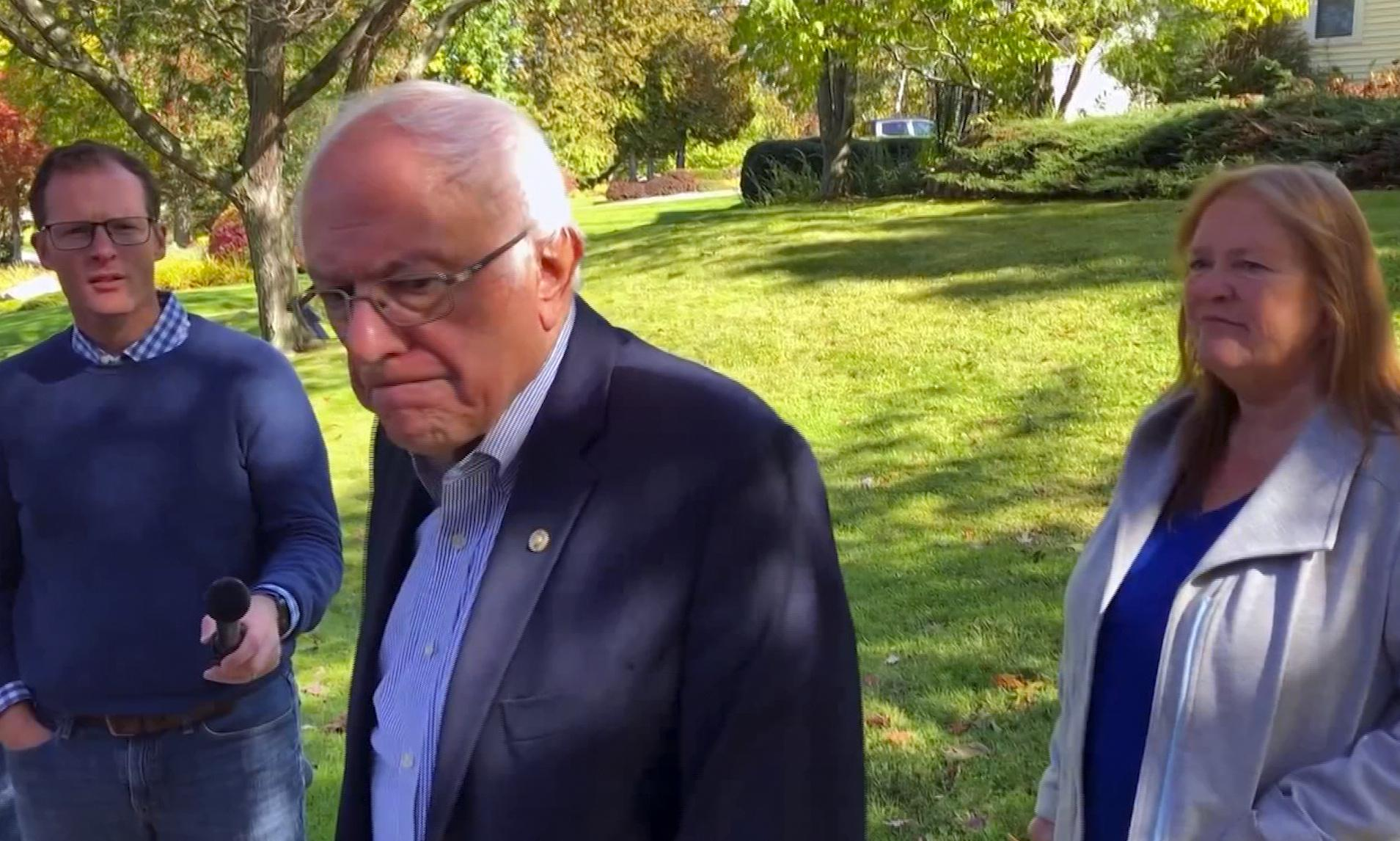 Sanders returns home after heart attack but will 'change the nature of campaign'