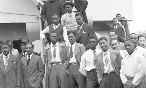Some of the Jamaican men, mostly ex Royal Air Force servicemen, aboard the former troopship, S.S. Empire Windrush, before disembarking at Tilbury Docks, England, on June 22, 1948.