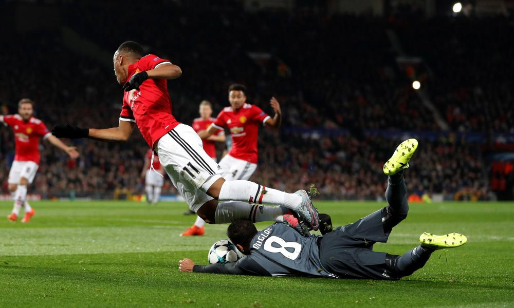 Anthony Martial is downed by Benfica's Douglas. Penalty awarded.