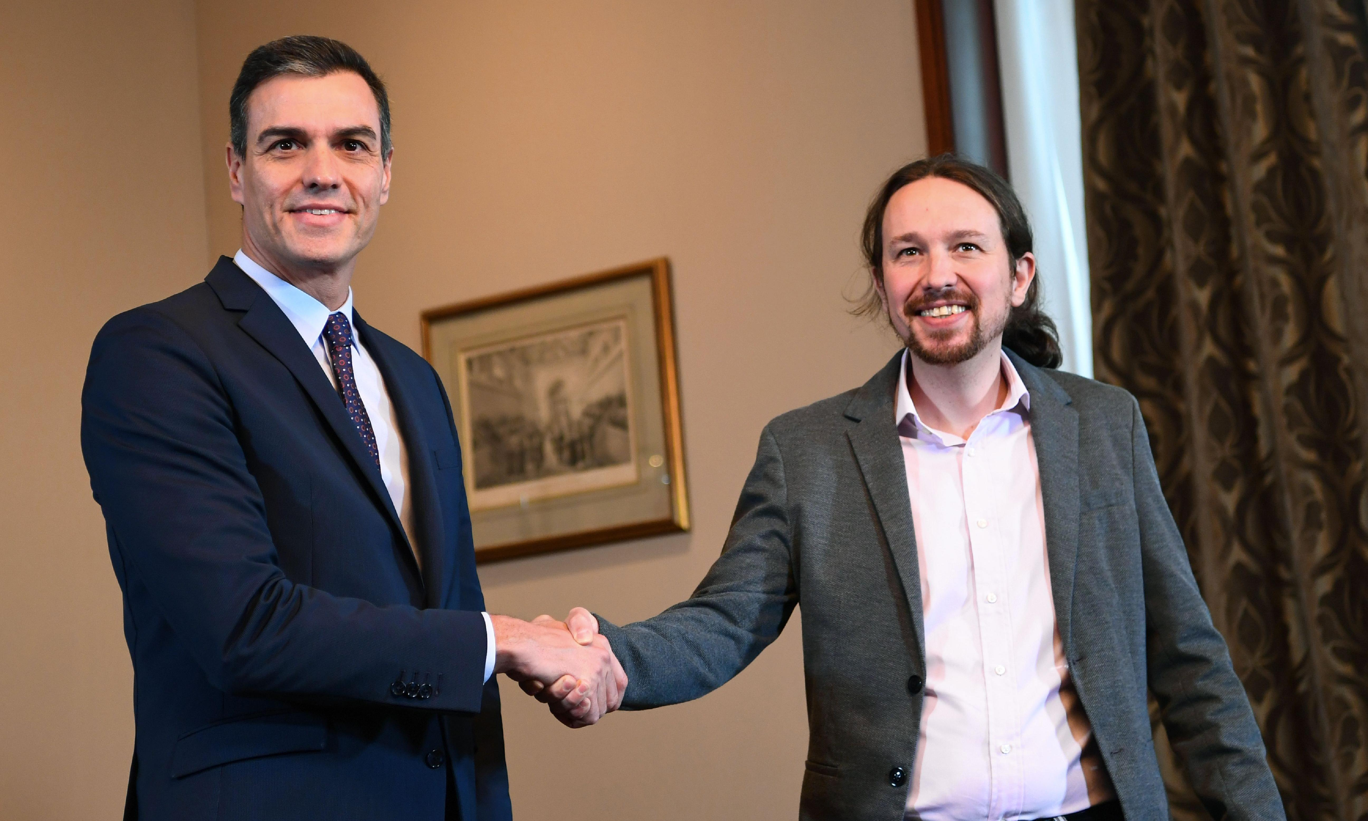 Spain's ruling socialists strike coalition deal with Podemos