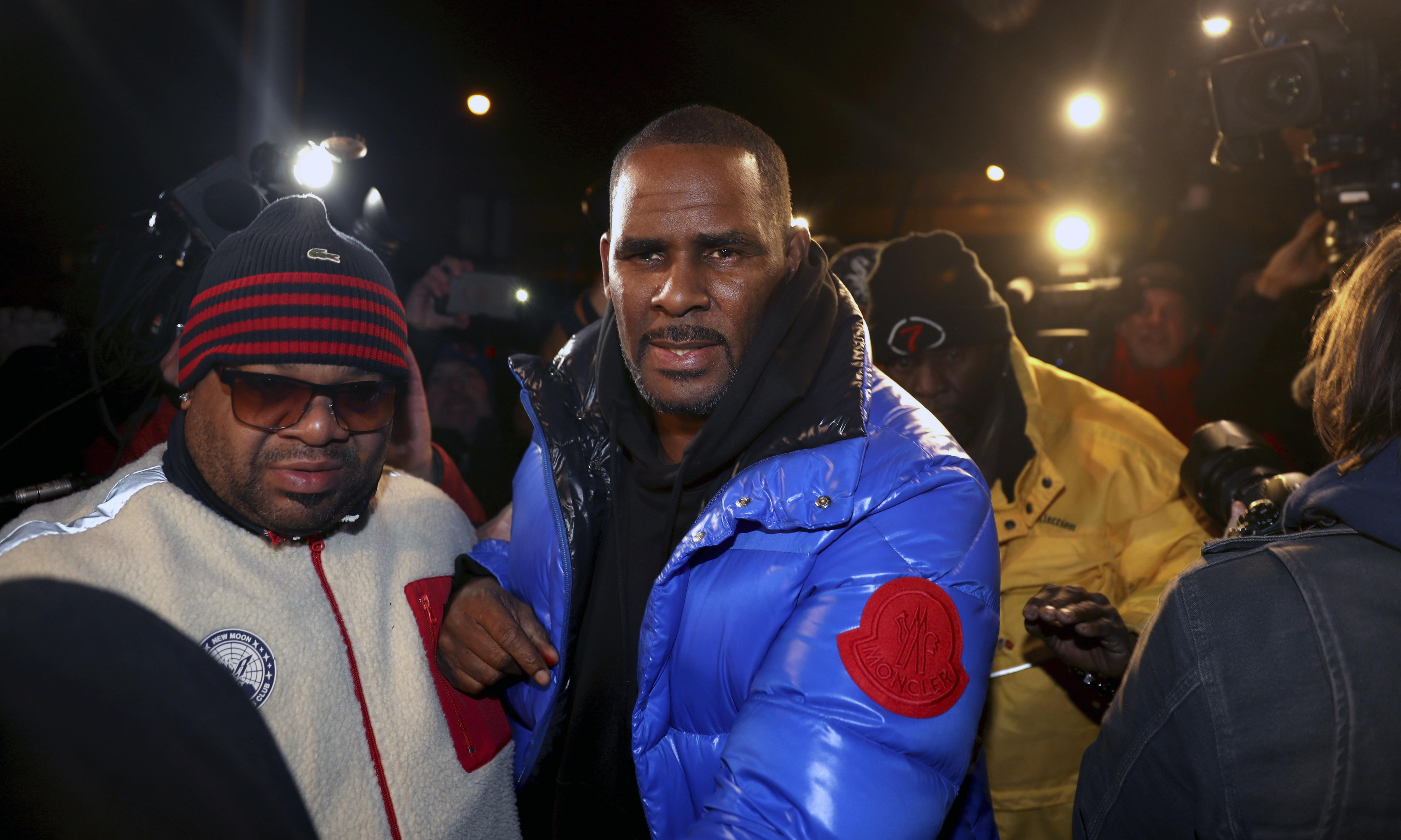 R Kelly in police custody after being charged with 10 counts of sexual abuse