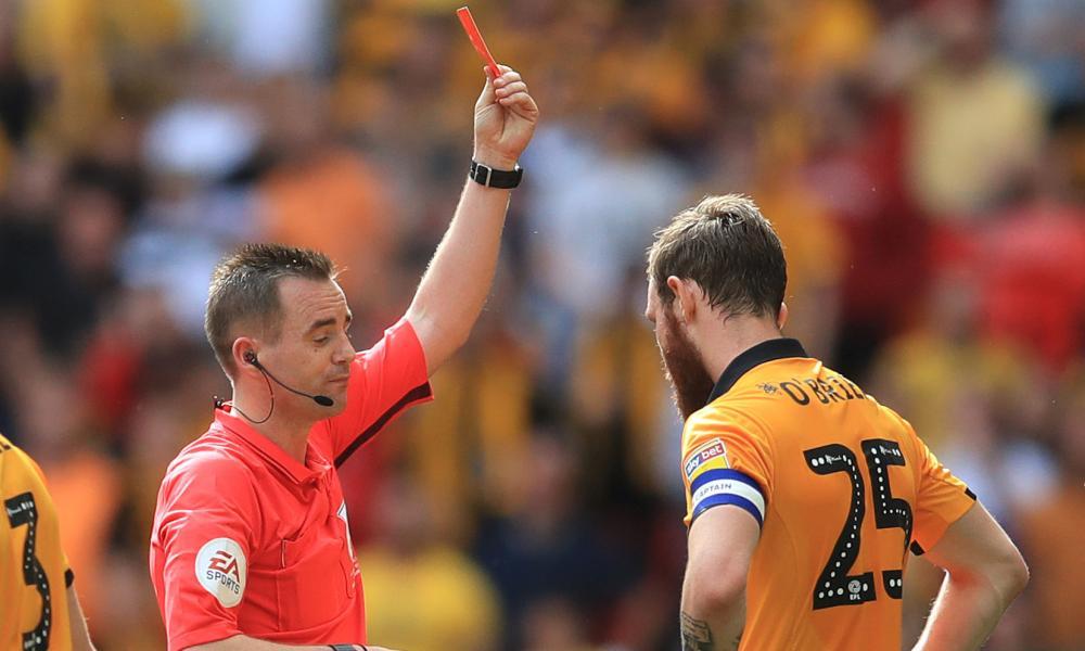 Mark O'Brien picks up a second yellow card.