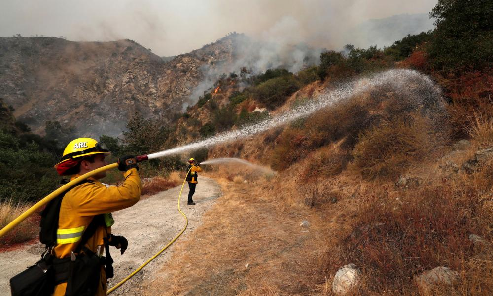 Firefighters work to extinguish the Bobcat Fire after an evacuation was ordered for the residents of Arcadia, in California.