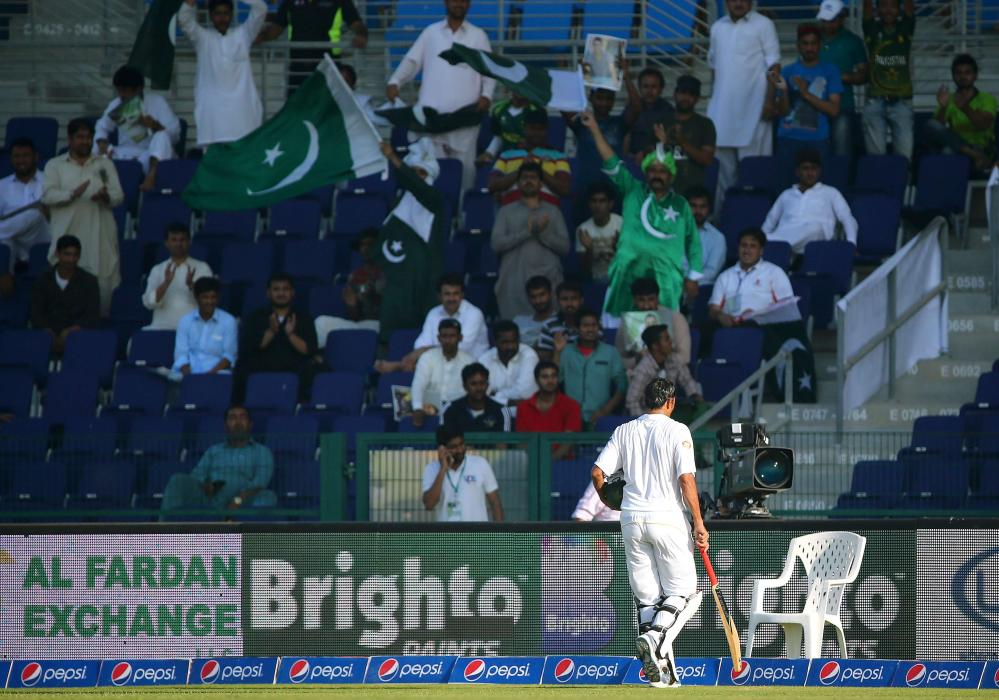 The record breaking batsman gets a well deserved round of applause as he leaves the pitch.