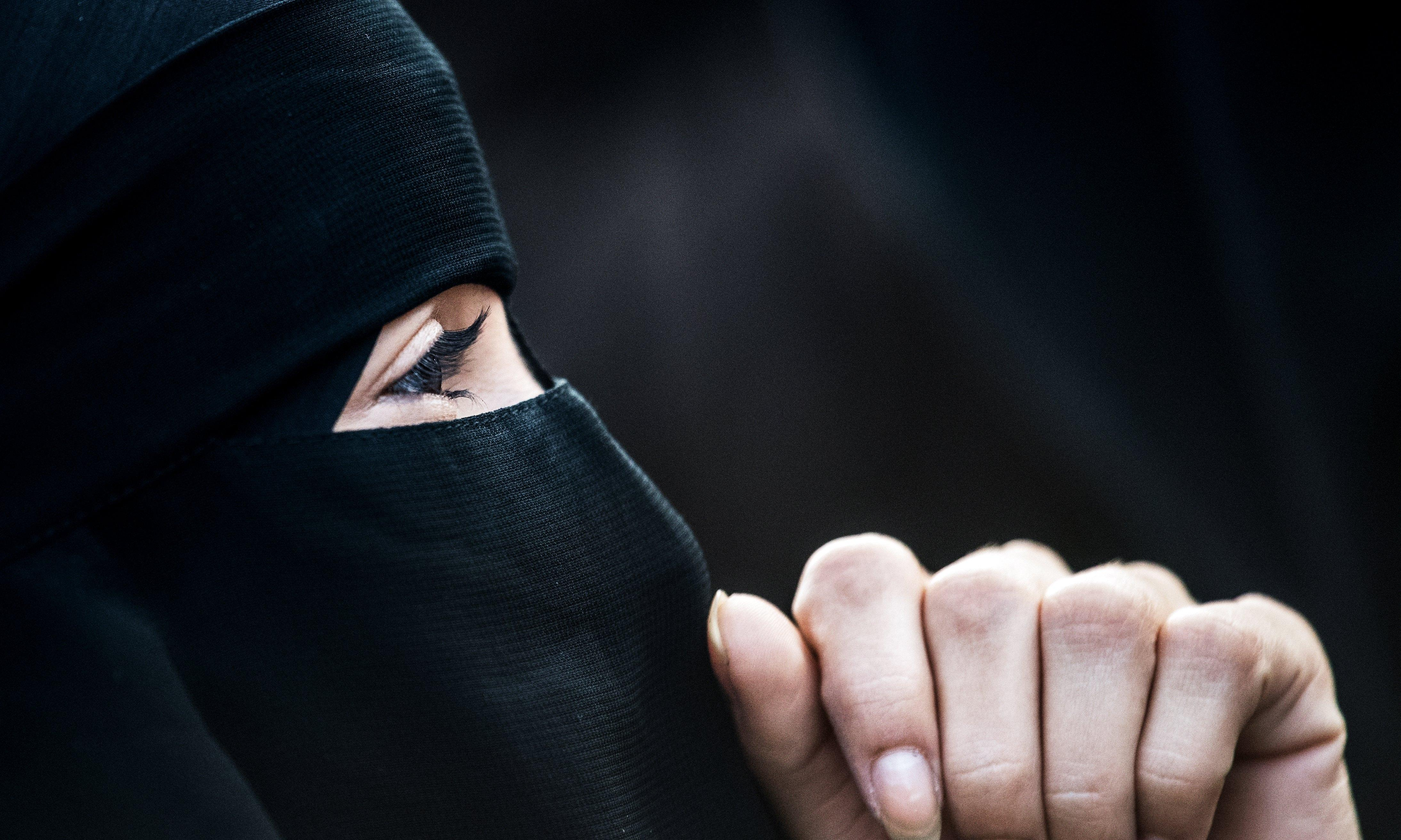 Quebec passes law banning facial coverings in public
