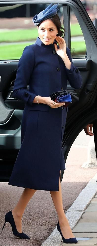 Power tailoring Meghan arrives at Eugenie's wedding.