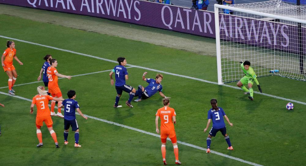 Netherlands' Lieke Martens (no 11) scores their first goal.