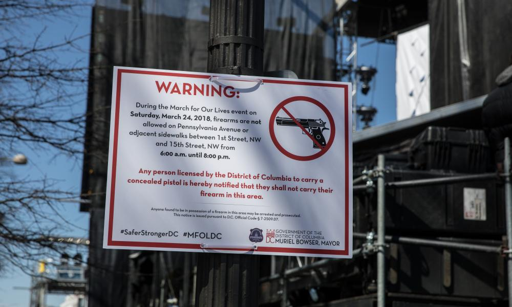 A sign prohibiting guns at the Washington march