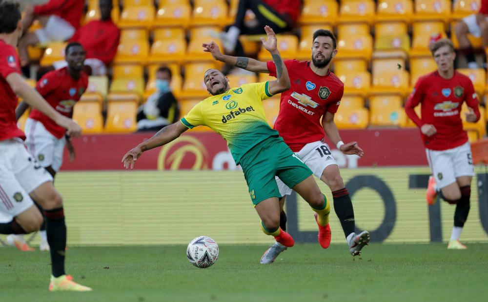 Bruno Fernandes downs Onel Hernandez of Norwich.