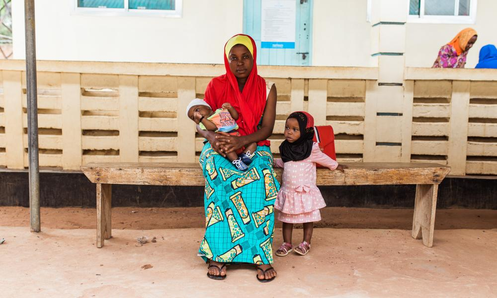 GSK Partnership - Tanzania Communication and Development Center (TCDC)TANZANIA - 6th MARCH 2019: Aisha, a mother at the community health center, who is supported by TCDC which is funded by Comic Relief and GSK partnership. Aisha is with her two children Bilal (boy) and Hajira (girl). The Tanzania Communication and Development Center (TCDC) is a recognized leader in the field of health communication. Specializing in social and behavior change communication, knowledge management, training and capacity building, and research and evaluation. (Photo by Sam Vox/Comic Relief)