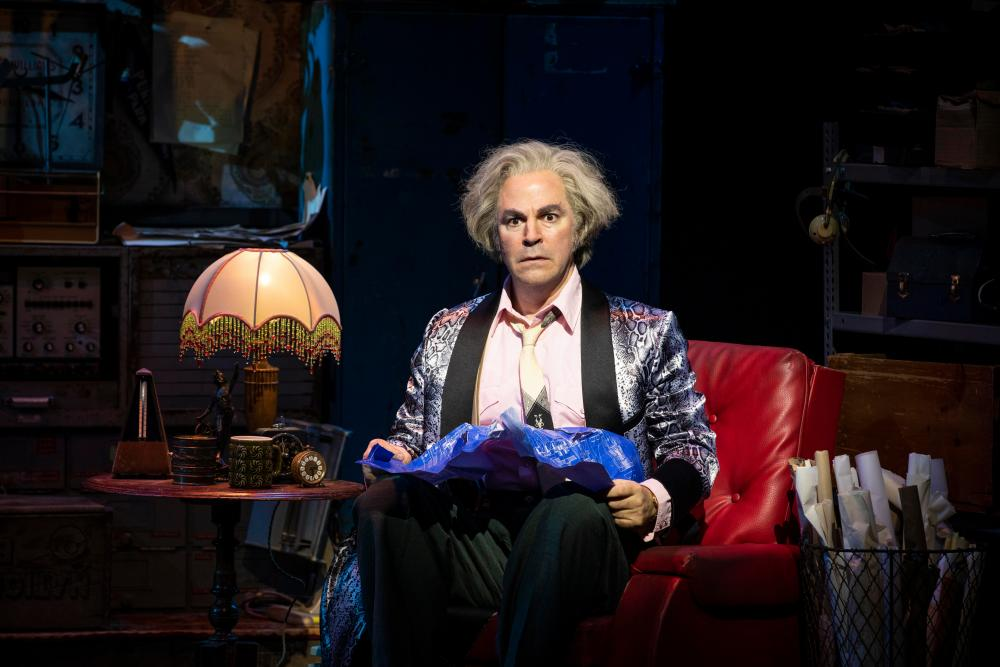Even more off-the-wall … Roger Bart as Doc.