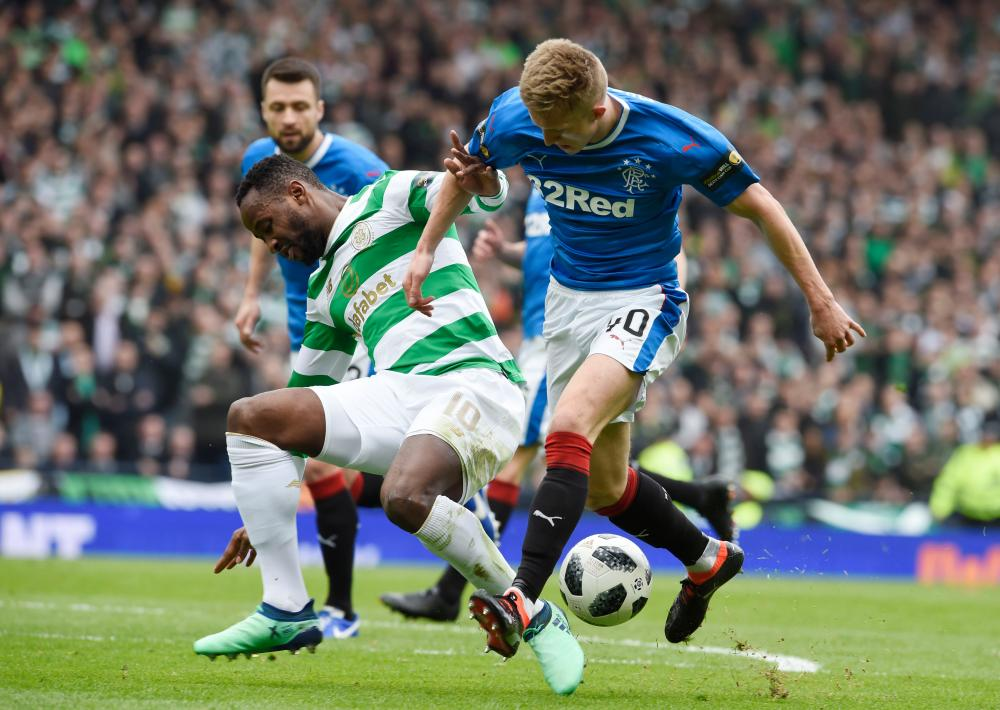 McCrorie takes down Dembele.