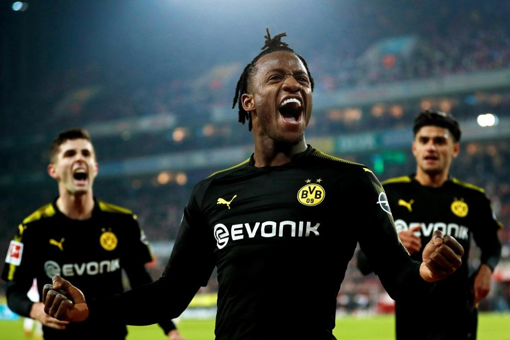 Michy Batshuayi celebrates after scoring for Dortmund.