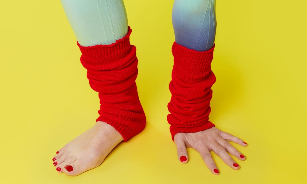 Photograph of foot and hand in leggings