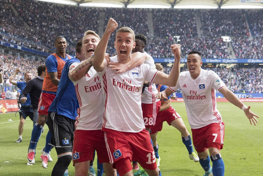 Joy for Hamburg after their late goal.