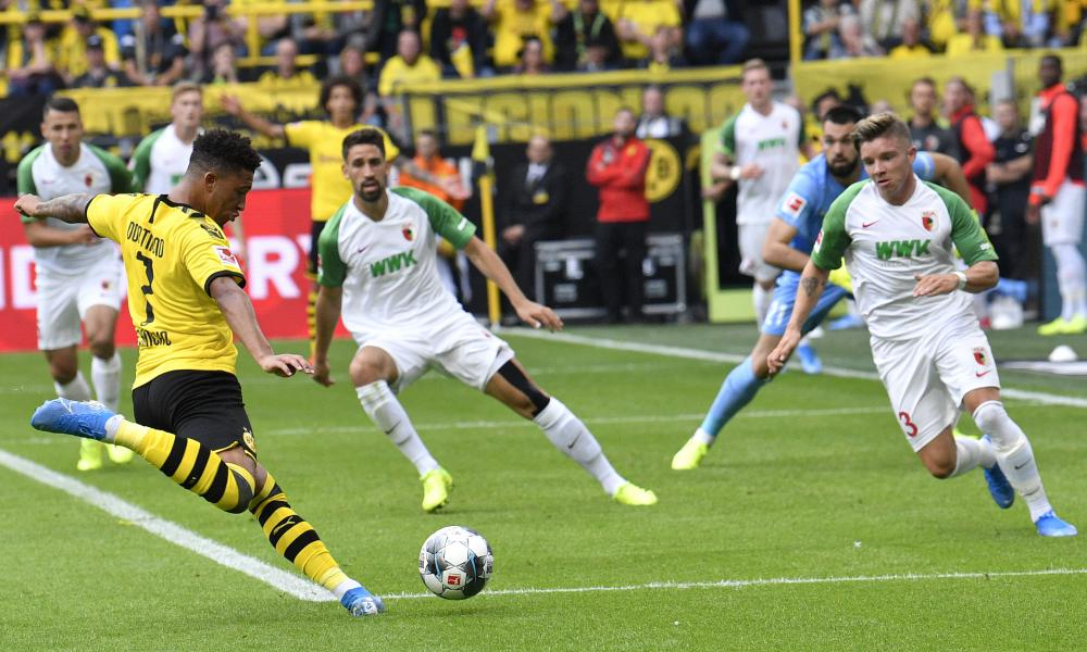 Borussia Dortmund's Jadon Sancho scores his side's second goal in a comfortable 5-1 win over Augsburg.
