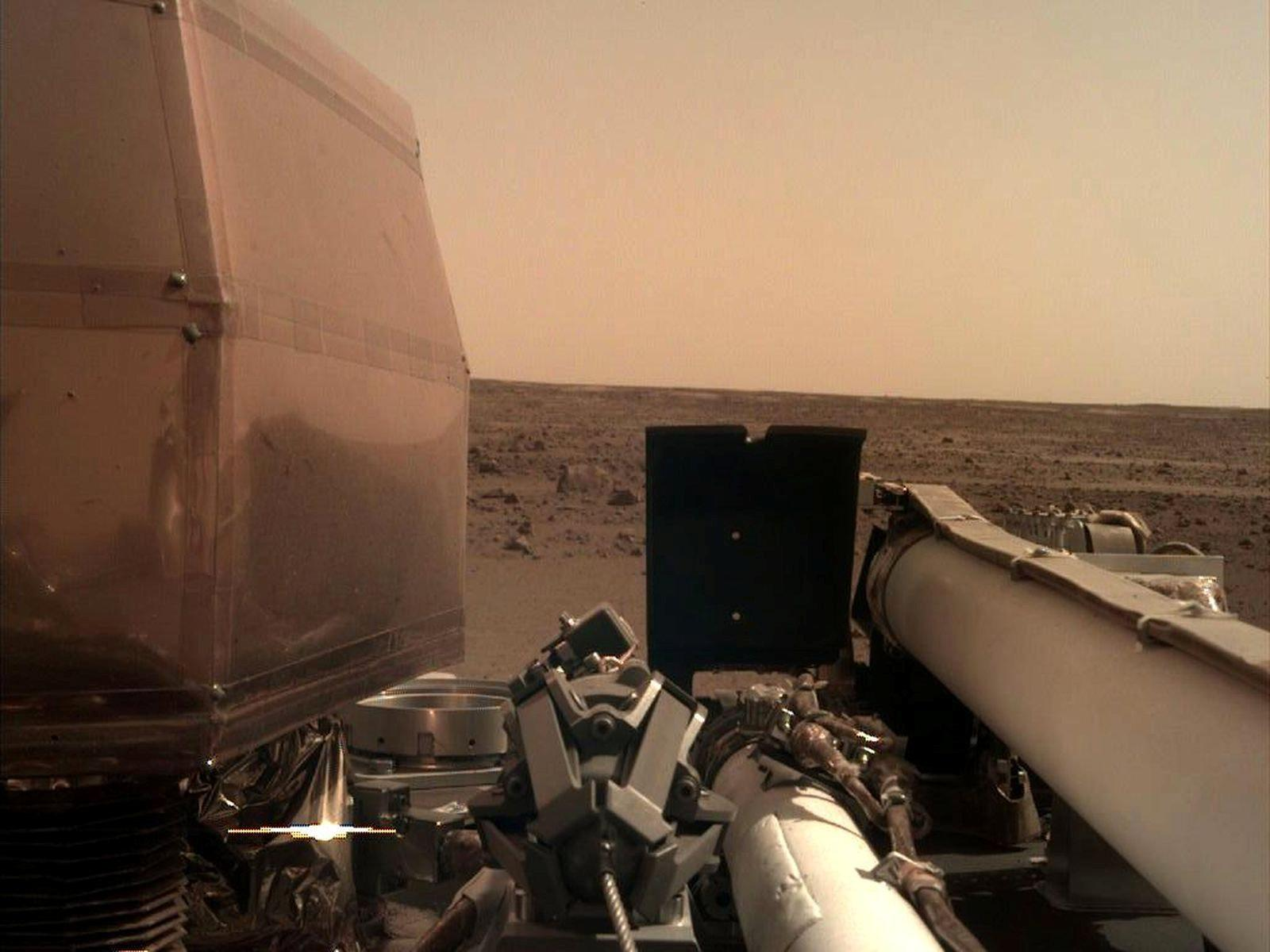 Nasa's Mars lander sends back first pictures from red planet