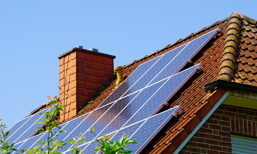 Roof of house with solar panels