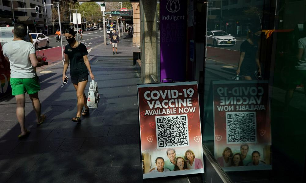 A sign advertising the availability of Covid vaccine doses outside a pharmacy in Sydney.