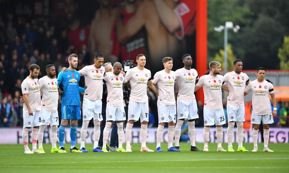 Manchester United observe the minute's silence.