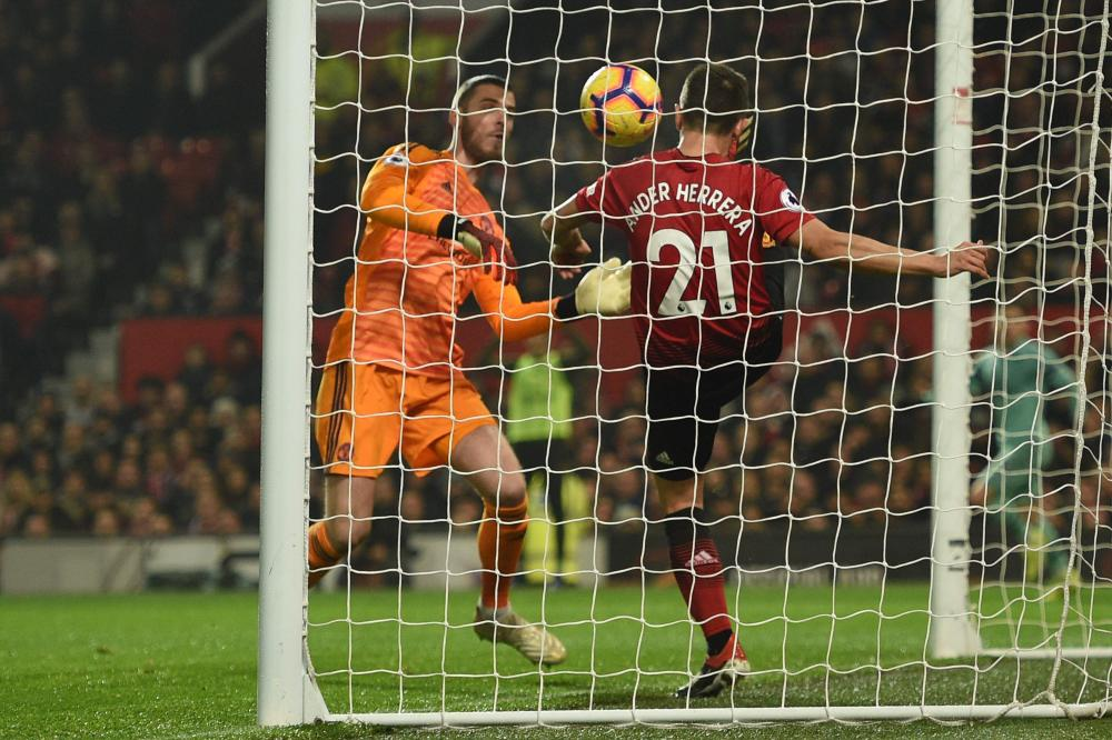 The ball crosses the goal line for Arsenal's first goal before Ander Herrera can clear it after David de Gea's blunder.
