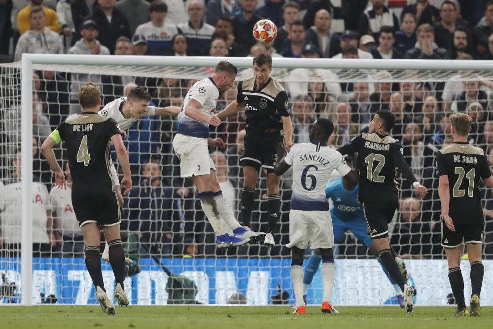 Tottenham's Toby Alderweireld, third from left, fails to score as he heads the ball over the bar.