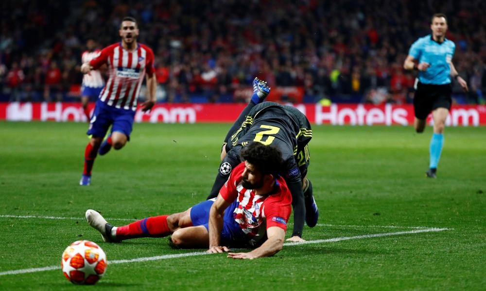 Juventus' Mattia De Sciglio fouls Atletico Madrid's Diego Costa and concedes a free kick
