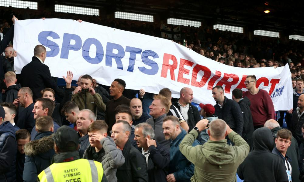 Newcastle fans hold up a banner in protest at Mike Ashley, who attended the game at Selhurst Park.
