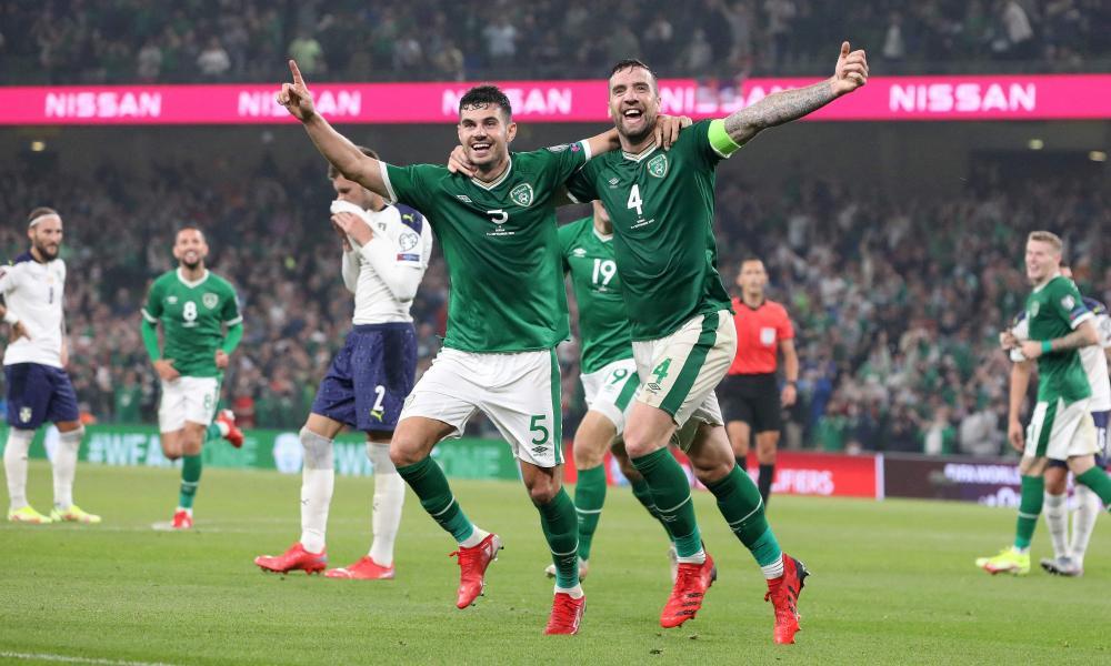 Republic of Ireland's defenders John Egan (L) and Shane Duffy (2L) celebrate after Serbia's defender Nikola Milenkovic scored an own goal.