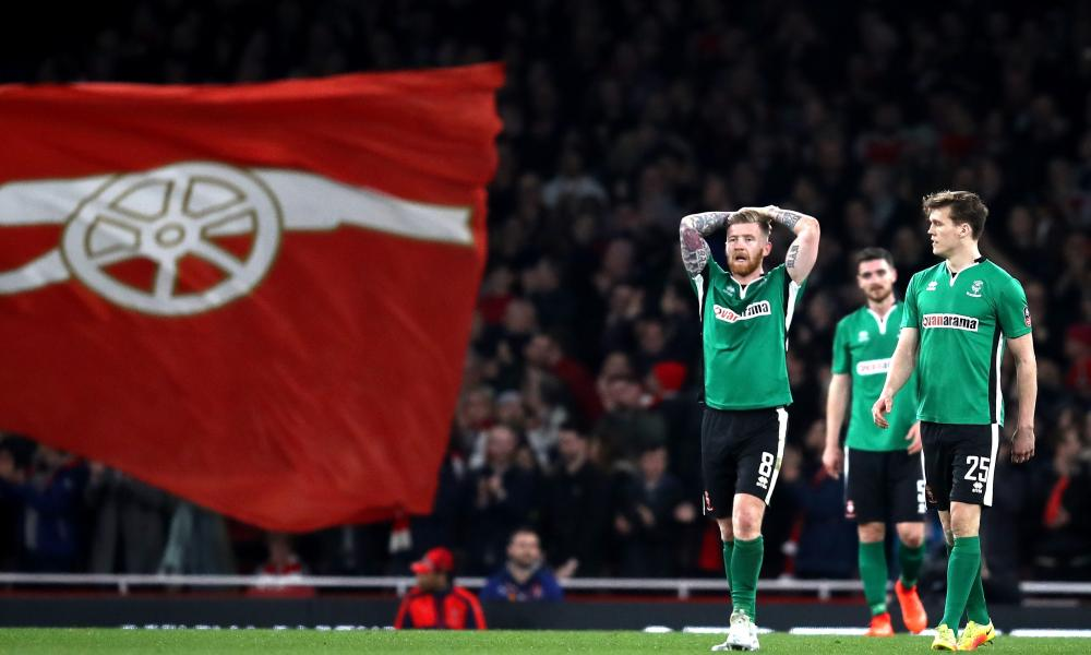Lincoln's Alan Power looks dejected after Arsenal took a 4-0 lead.