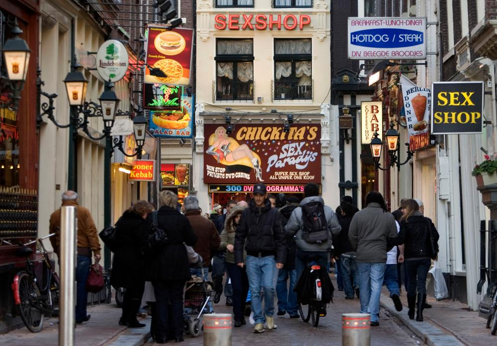 Amsterdam's red light district in 2008. Many 'windows' have since been closed down in an effort to cleanse the area of organised crime.