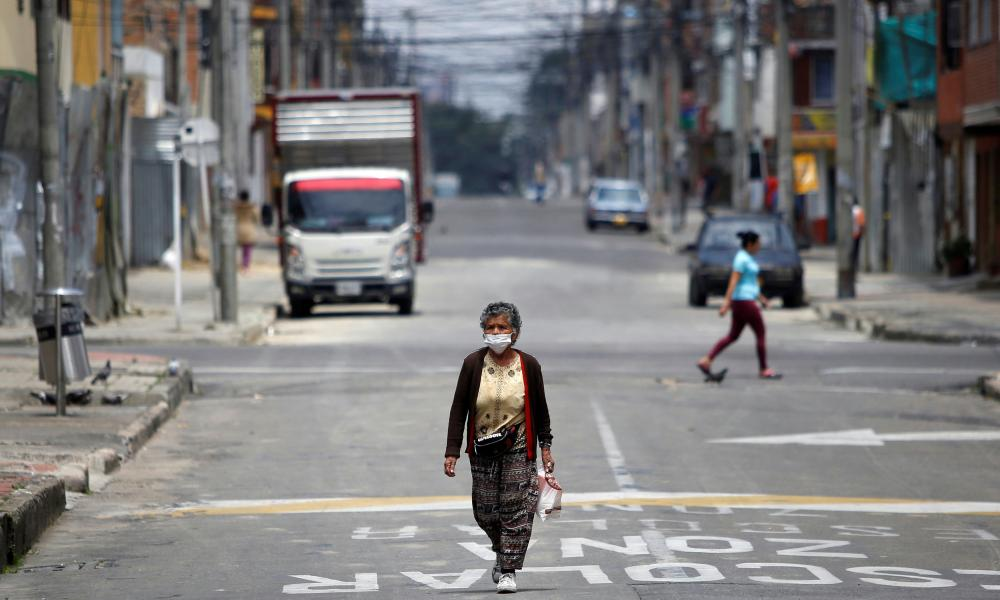 A woman wearing a face mask in Bogota.