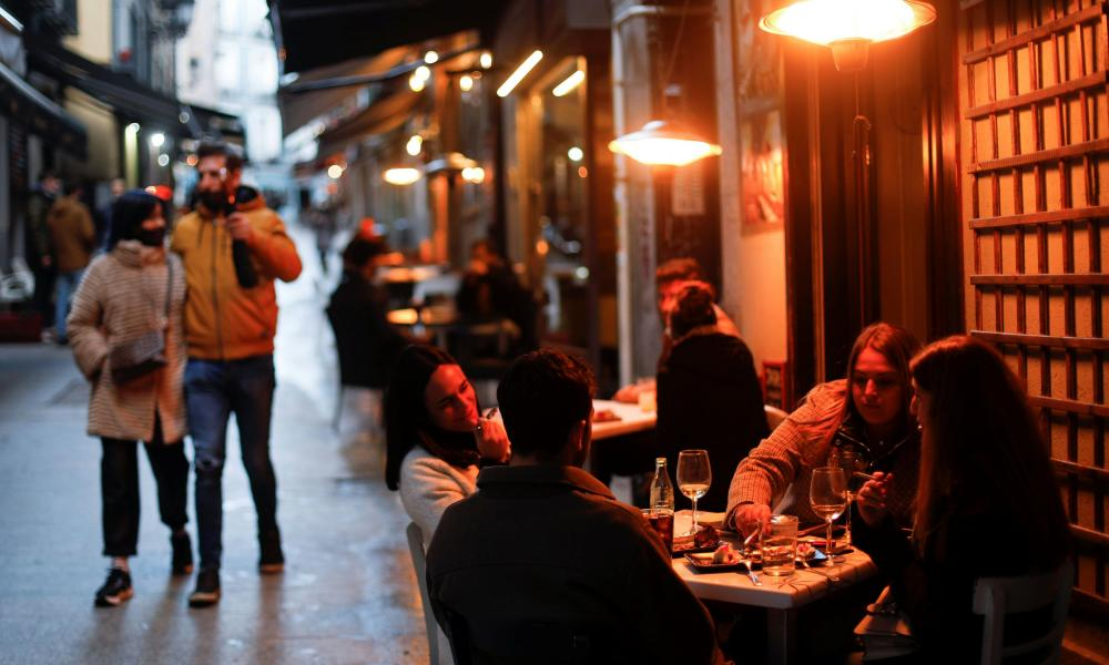 People sit at an outdoor terrace in Madrid