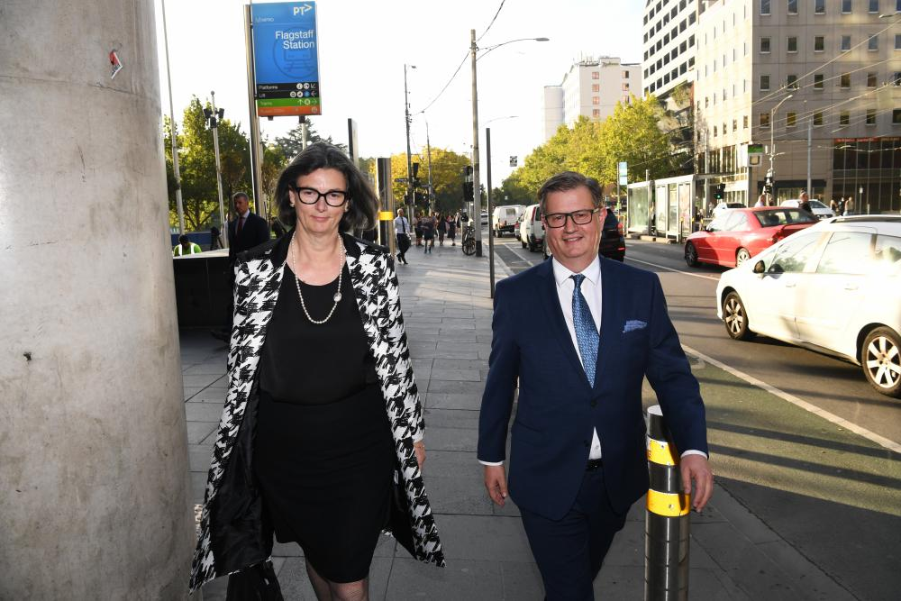 Andrew Hagger (right), the chief customer officer of the National Australia Bank, leaves the federal court in Melbourne