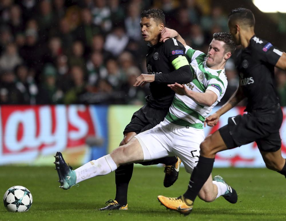 Paris Saint-Germain's Thiago Silva, left, and Celtic's Anthony Ralston challenge for the ball.