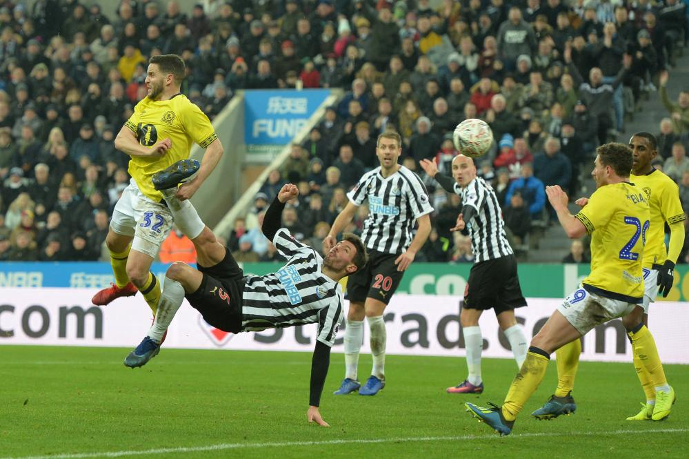 Fabian Schar of Newcastle attempts an overhead kick.