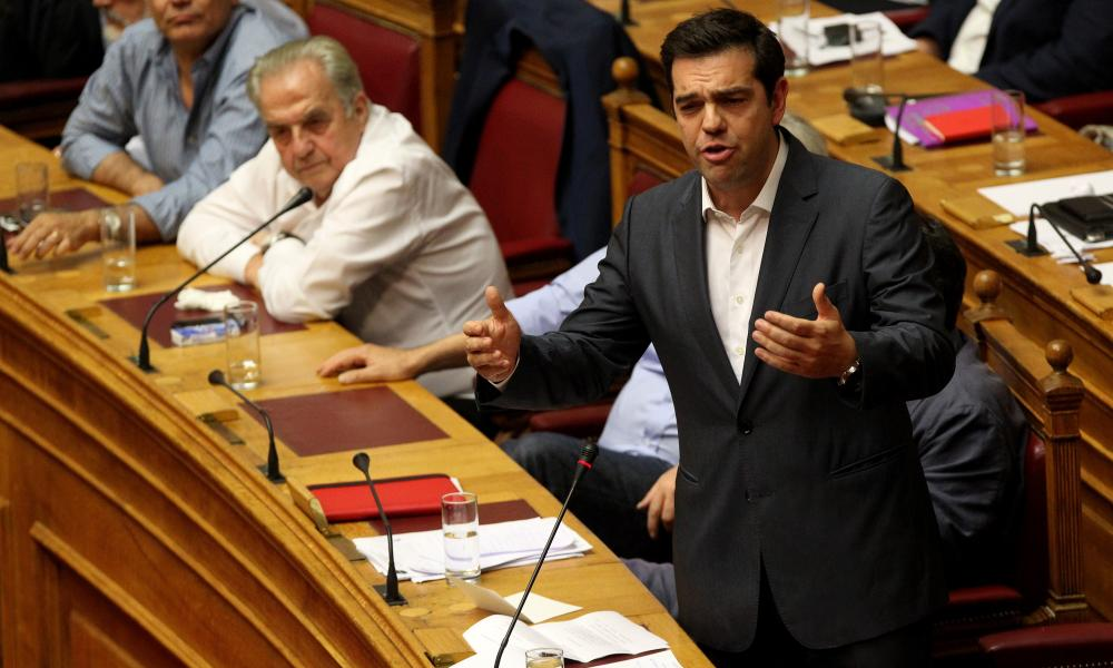 Greek prime Minister Alexis Tsipras (R) addresses parliament during debate on bailout deal