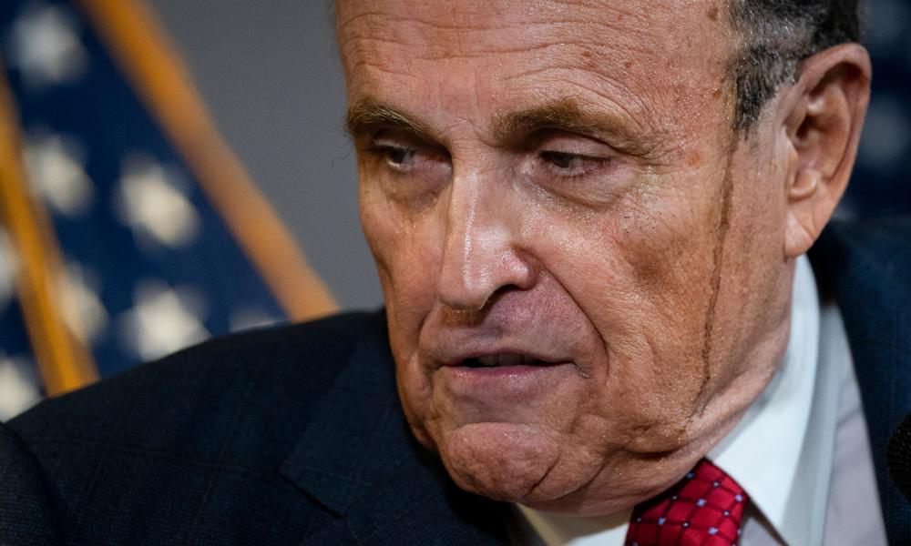 Rudy Giuliani offered a balanced presentation: both sides of his face sported dark streaks.