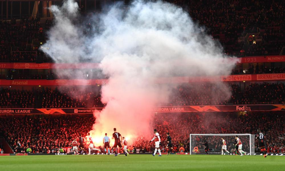 Rennes fans set off flares in the away end at the Emirates Stadium.