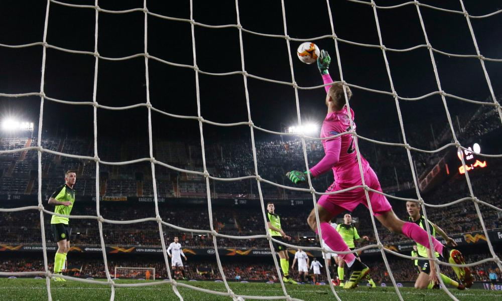 Celtic's Scott Bain makes a save from Valencia's Dani Parejo.