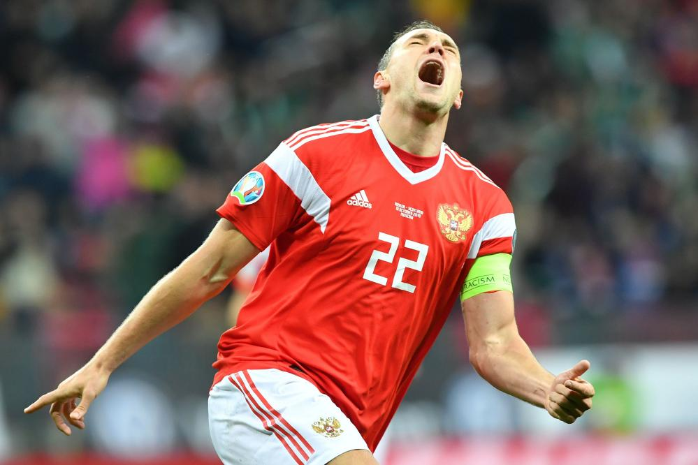 Dzyuba celebrates after scoring the first for Russia against Scotland.