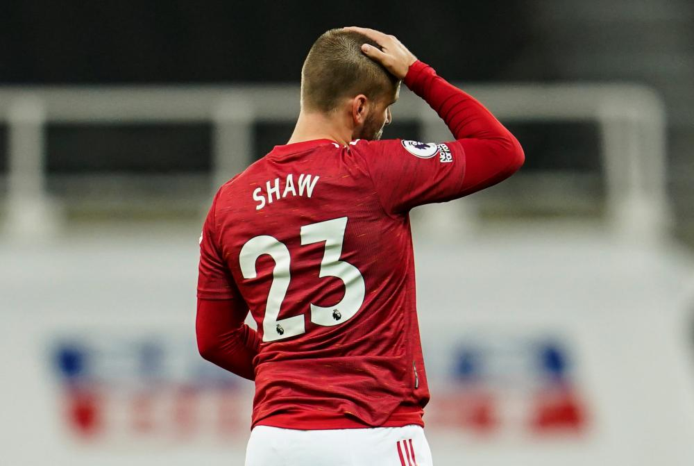 Shaw dejected following his own goal
