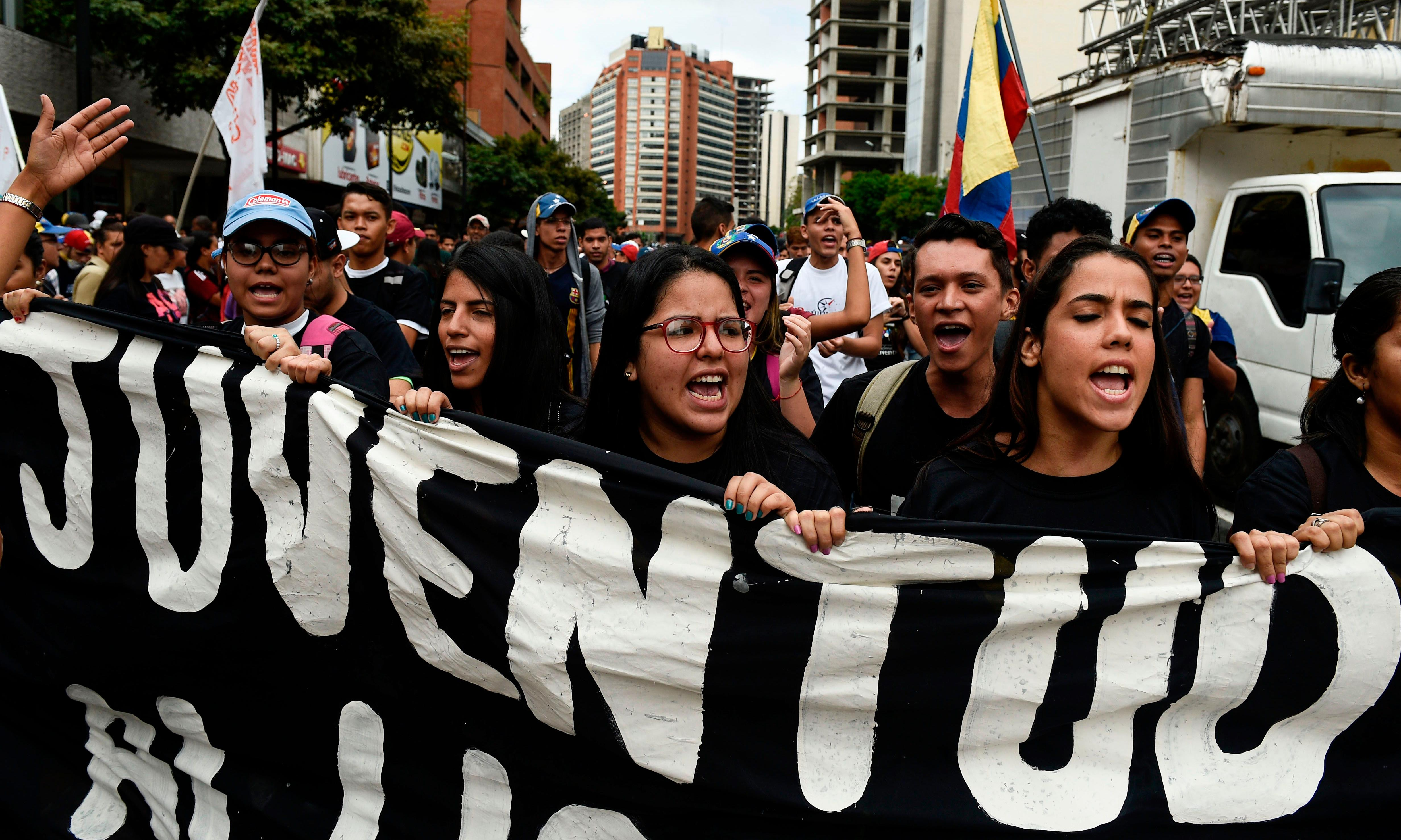 Venezuela protests: thousands march as military faces call to abandon Maduro
