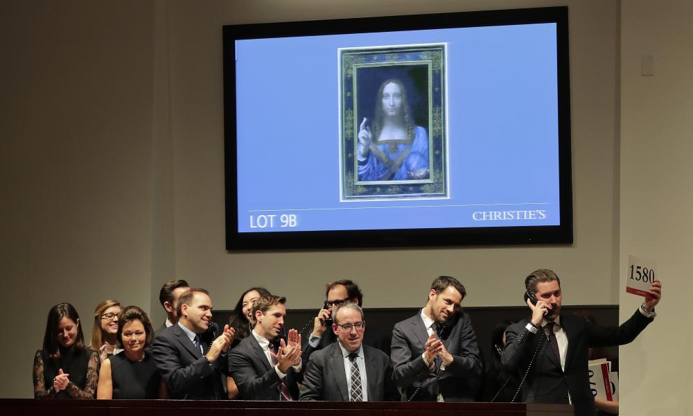 Bidding representatives react after Leonardo da Vinci's Salvator Mundi sells.